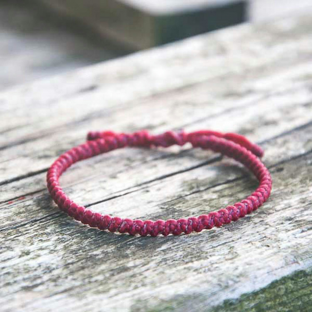 Red yoga bracelet. Plain string available in 18 colours. Waterproof.
