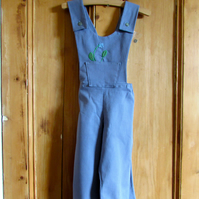 Child's dungarees in blue.