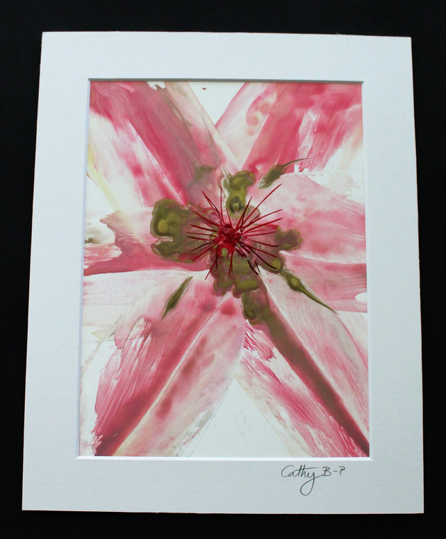 Unique encaustic wax flower in pink and gold on a white background, mounted
