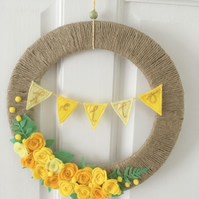 Felt flower wreath with mini bunting