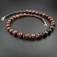 Red tiger eye and Karen Hill tribe rose gold necklace, Capricorn jewellery