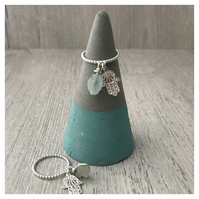 Sterling silver beaded wire stacking ring with aquamarine and hamsa charm