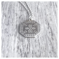 Geometric pendant with an Indian floral henna pattern print in sterling silver