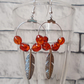 Amber Beaded Hooped Earrings with Silver Coloured Feather Decoration