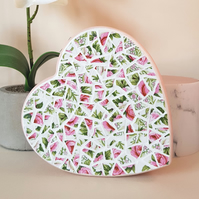 Heart shaped boxed covered in pink and green mosaic