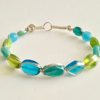 Multi coloured silver plated wirework bracelet with glass beads