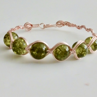 Rose Gold Celtic style bracelet with Moss green Glass beading