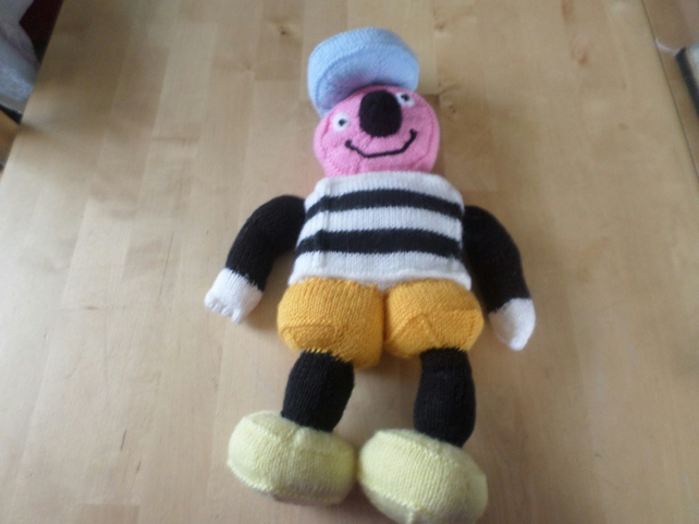 Hand knitted soft toy of Bertie Bassett