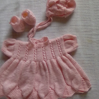 A hand knitted 3 piece set in pale pink to fit 3 months