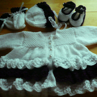 Hand Knitted 4 piece set in white with purple frill to fit baby up to 16 lbs