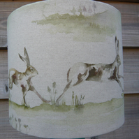 Lampshade featuring Running hares print on a linen mix fabric 20cm diameter