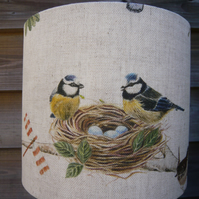 Lampshade featuring blue tits, wren, robin & butterfly in a silver birch tree