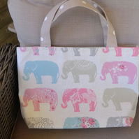 Pretty, handmade, lined tote bag with pastel elephants on a neutral background