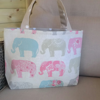 Handmade and lined tote bag with pastel elephant fabric on a natural background