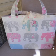 Handmade fully lined tote bag in a soft pastel elephant fabric with lace ties