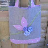 A lovely one off designed bag with handmade flowers and appliqued leaves