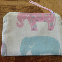 Handmade zipped purse in a pretty elephant fabric