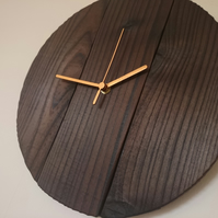 Rustic recycled round wooden wall clock with burnt finish and gold hands