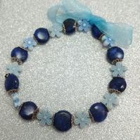 Blue flower and Lapis Lazuli gemstone expandable bracelet