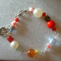 Vibrant beaded bracelet with heart charm