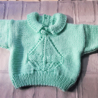 Baby sweater with yacht motif