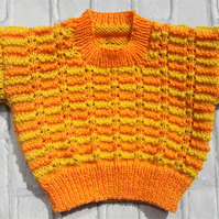 Baby sweater with knitted lace effect pattern