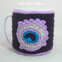 Crochet purple peacock feather mug cosy, mug hug.
