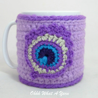 Crochet lilac peacock feather mug cosy, mug hug