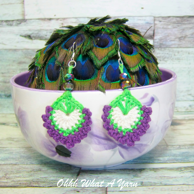 Crochet, embroidered and beaded peacock feather earrings.