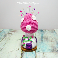 Crochet pink toadstool fairy house pin cushion, ornament.