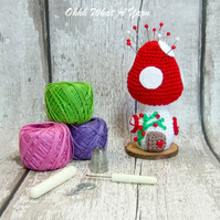 Crochet red toadstool fairy house pin cushion, ornament.
