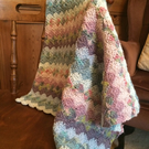 Handmade crochet baby blanket by Rico design- multi coloured cotton