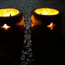 A pair of wonderful rustic star tea light holders handmade