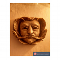 Medieval green man wall boss grotesque