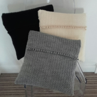 Pompom Trim knitted cushion