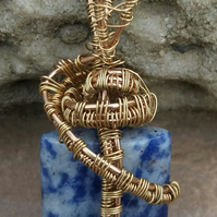 Gold wire wrapped blue stone