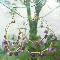 Gold hoop earrings with amethyst stones