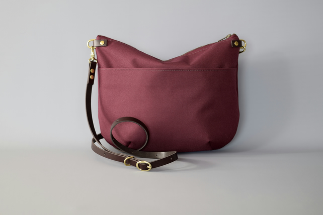 Red waterproof canvas cross body bag by HOLMgoods
