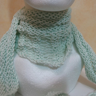 Knitted scarf in pale pistachio green