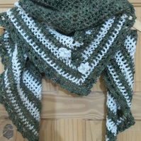 Crochet road trip shawl in olive green and cream