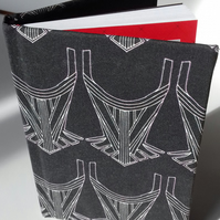 A6 Notebook covered with fabric from original design-Betsy Careless wears black