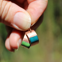 Mismatched copper and enamel green and blue curved earrings