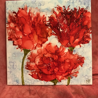 Bright red alcohol ink hand painted flowers on square ceramic tile