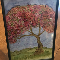Blossom tree in a black A4 frame.