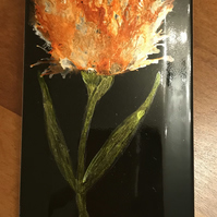 Hand painted fiery orange alcohol ink tulip on black tile. Original art.