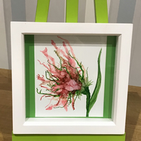 Pink alcohol ink flower in white box frame.