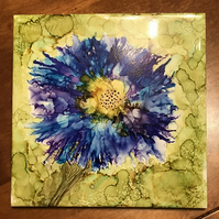 Bright blue and yellow alcohol ink flower on large square tile, original art.