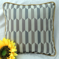 Geometric pattern cushion cover with Gold coloured trim.