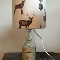 Stag lampshade with malt whisky glass bottle base