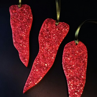 red sparkly wooden chillies
